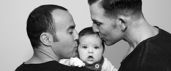 "SYDNEY, AUSTRALIA - MAY 30: (EDITORS NOTE: Image has been converted to black and white.) (L-R) Sydney couple, Faycal Dow, aged 38, daughter Myla Dow, aged 2 months, and Hunter Dow, aged 44, pose during a portrait session on May 30, 2015 in Sydney, Australia. Faycal and Hunter were legally married in France last year and had their first child Myla this year and are supporters of same-sex marriage. "" For the sake of our daughter more than anything, it is important that our marriage is recognised as valid in Australia, the country we live in and hope to bring our beautiful daughter up in"", said Hunter. The marriage equality debate in Australia has reignited on the back of Ireland's referendum legalising same-sex marriage last week. Recent polls suggest public support for gay marriage in Australia is at an all-time high of 72%.  (Photo by Don Arnold/Getty Images)"